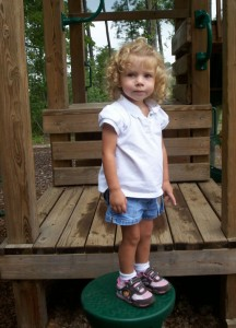 Riley poses for Grandma Nancy in the park near her home.