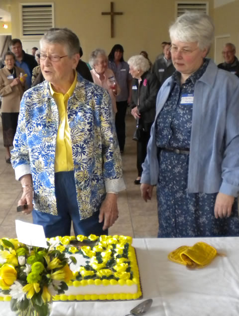 Julia Jane Nehls at birthday cake with Sister Faith Margaret