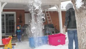 Snow cascade falls into tubs.